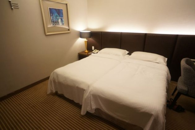 ザ メトロホテル (豪爵大飯店)のベッド